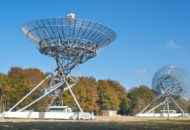 A photo of two big radio antennas.